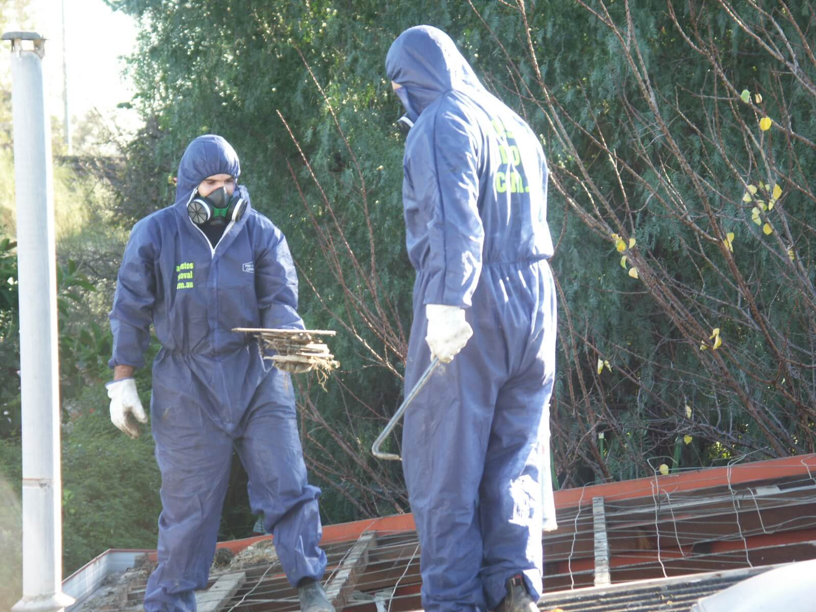 Suits And Breathing Apparatus Protect Asbestos Removal Workers