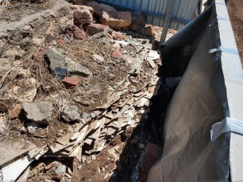 Smashed asbestos fence panels - need legal disposal